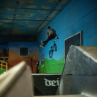 CLEVELAND - APRIL - A BMX rider pulls a No-Footed Can-Can in Transferland at Rays Indoor Mountain Bike Park in Cleveland, Ohio. (photo by Bryan Mitchell)