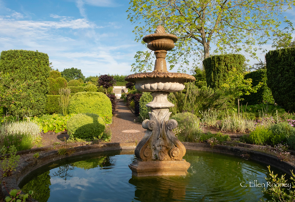 A carved stone fountain in Fountain Court at the Laskett Gardens, Much Birch, Herefordshire, UK