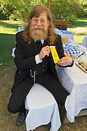 Old Bethpage, New York, U.S. 29th September 2013. NORMAN ERIKSON, of Greenlawn, is wearing a reproduction of a yellow Reunion Ribbon for the Grand Army of the Republic, Moses Baldwin Post 544, at The Long Island Fair. A yearly event since 1842, the county fair is now held at a reconstructed fairground at Old Bethpage Village Restoration.