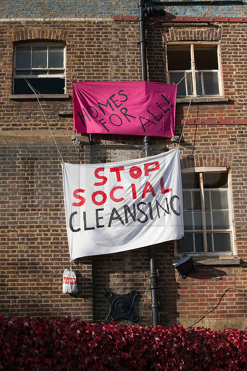 © Licensed to London News Pictures. 29/10/2013. London, UK. Banners erected by squatters occupying an 1820s property that was sold at auction on Monday for GB£3m are seen on the edge of London's Borough Market today (29/10/2013). The Grade II-listed building, sold by Southwark Council to build 20 new council homes, had been empty for years before squatters from Housing Action Southwark and Lambeth (HASL) moved in. The property, formerly owned by Courage brewers, was acquired by Labour-controlled Southwark Council when the Greater London Council was wound up in 1986. Photo credit: Matt Cetti-Roberts/LNP