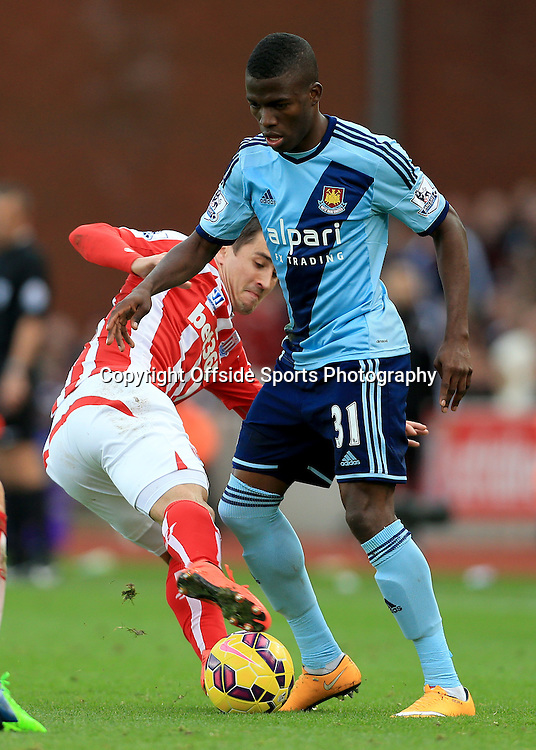 1st November 2014 - Barclays Premier League - Stoke City v West Ham United - Bojan Krkic of Stoke battles with Enner Valencia of West Ham - Photo: Simon Stacpoole / Offside.