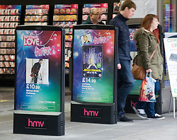 © Licensed to London News Pictures. 19/12/2011. London, UK. HMV store on Oxford Street, London today (19/12/2011). Like-for-like sales at music retailer HMV fell by 11.6% over the past six months, it has been reported.The troubled high street chain also announced a loss before tax of £36.4m in its first half results. Photo credit: Ben Cawthra/LNP