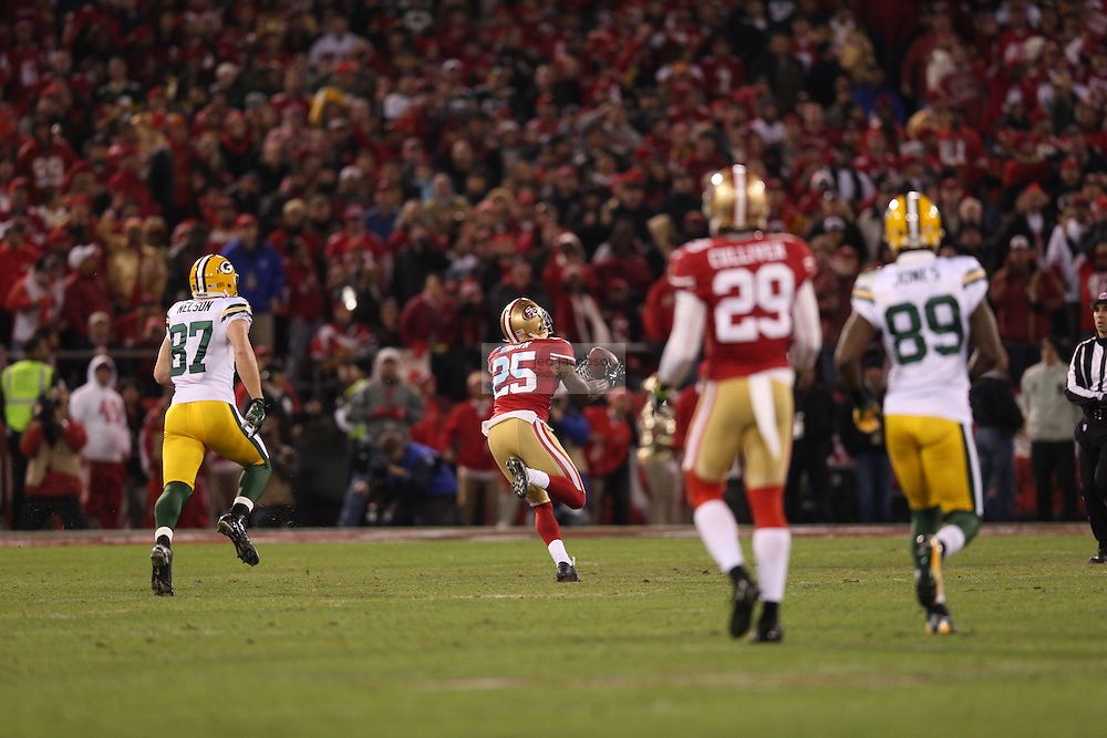 San Francisco 49ers cornerback Tarell Brown (25) intercepts a pass during a NFL Divisional playoff game against the Green Bay Packers at Candlestick Park in San Francisco, Calif., on Jan. 12, 2013. The 49ers defeated the Packers 45-31. (AP Photo/Jed Jacobsohn)