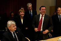14 DEC 2003, BERLIN/GERMANY:<br /> Joschka Fischer, B90/Gruene, Bundesaussenminister, Angela Merkel, CDU Bundesvorsitzende, Henning Scherf, SPD, 1. Buegermeister Bremen, und Gerhard Schroeder, SPD, Bundeskanzler, (v.L.n.R.), begruessen sich, vor Beginn der Sitzung des Vermittlungsausschusses, Bundesrat<br /> IMAGE: 20031214-01-076<br /> KEYWORDS: Gespräch, Gespraech, Gerhard Schröder, Begruessung, Begrüssung,