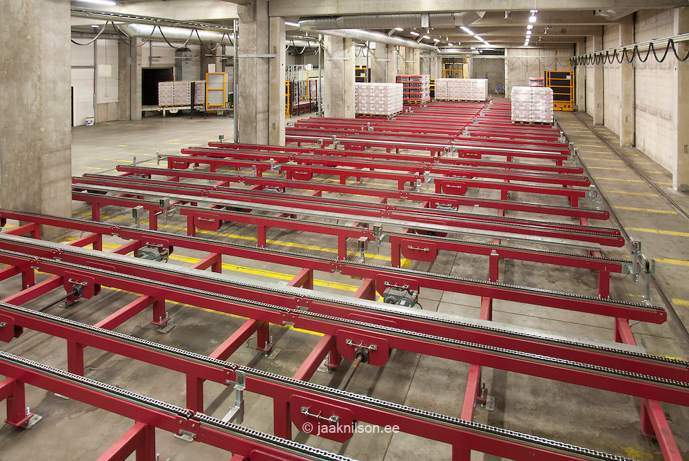 Warehouse and distribution centre for goods. Steel platforms and pallets, lifting equipment and racking.