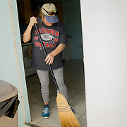 MARATHON, FL - SEPTEMBER 16: <br /> Kathy Thompson, sweeps water out of the Marathon Church of Christ,  where her husband Tim is the Minister. They had just arrived after evacuating to Homestead on September 16, 2017 in Marathon, Florida.  (Photo by Angel Valentin/Getty Images)