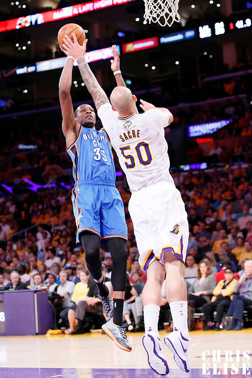 09 March 2014: Oklahoma City Thunder small forward Kevin Durant (35) goes for the jumpshot over Los Angeles Lakers center Robert Sacre (50) during the Los Angeles Lakers 114-110 victory over the Oklahoma City Thunder at the Staples Center, Los Angeles, California, USA.