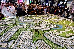 Model of new luxury housing estate at Akoya Park by developer Damac at property trade fair in Dubai United Arab Emirates