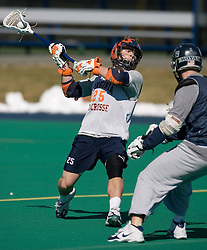 Virginia Cavaliers M Joe Dewey (25) shoots against Georgetown.  The #1 ranked Virginia Cavaliers Men's Lacrosse team scrimmaged the #6 Georgetown Hoyas at the University of Virginia's Turf Field in Charlottesville, VA on February 10, 2007.