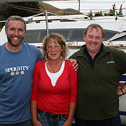 Peter McGrouther, Janet Wilden and Jeff Burrow after sailing from Kingston to Queenstown in competition on Lake Wakatipu. The race was to commemorate the voyage by raft of early settler Donald Hay who was the first person known to have made the Kingston to Queenstown crossing, in 1859. Queenstown, South Island, New Zealand. 18th February 2012. Photo Tim Clayton