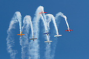 A aerobatic team of Yakovlev Yak-52 aircraft perform a loop at Wings Over Wairarapa over Masterton, New Zealand in 2013