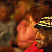 Maurice M. Martinez, a professor at UNCW's Watson College of Education, watches pianist Grenoldo Frazier perform Thursday September 5, 2013 at Cameron Art Museum in Wilmington, N.C. Martinez produced and directed a documentary about Frazier titled The Piano Entertainer: Stompin' Grenoldo Frazier.  (Jason A. Frizzelle)