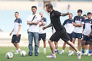 NANJING, CHINA - JUNE 18: (CHINA OUT) <br /> <br /> David Beckham Visits Jiangsu Sainty Football Club<br /> <br /> David Beckham kicks a ball during his meeting with Jiangsu Sainty players at Nanjing Olympic Sports Centre on June 18, 2013 in Nanjing, Jiangsu Province of China.  <br /> ©Exclusivepix