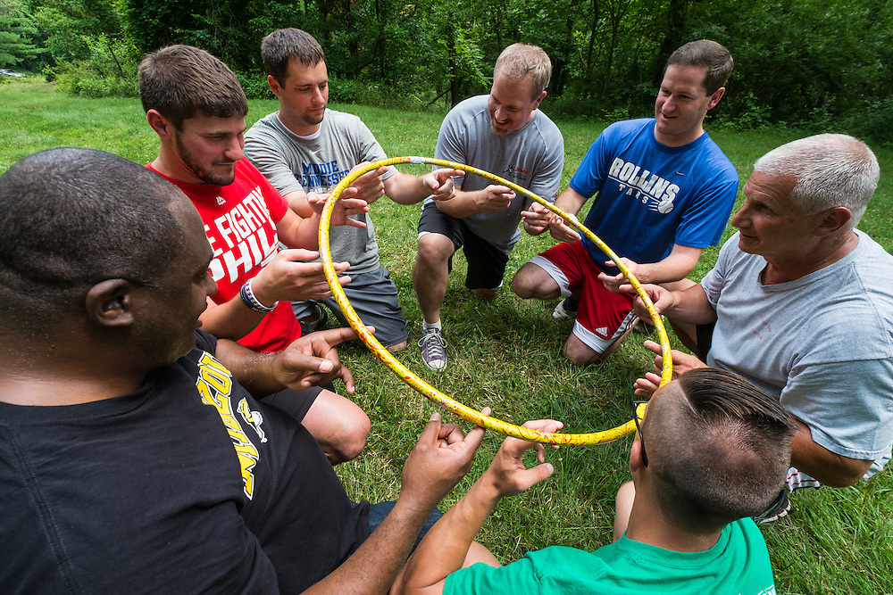 "A team of MAA students attempt to lower a hula hoop to the ground during the ""Helium Stick"" at The Ridges on Friday, June 26, 2015. © Ohio University / Photo by Rob Hardin"