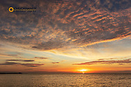 Vivid sunrise clouds over the Atlantic Ocean from Higgs Beach in Key West,Florida, USA