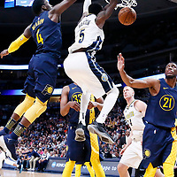 03 April 2018: Denver Nuggets forward Will Barton (5) dunks the ball past Indiana Pacers guard Victor Oladipo (4) over Indiana Pacers forward Thaddeus Young (21) during the Denver Nuggets 107-104 victory over the Indiana Pacers, at the Pepsi Center, Denver, Colorado, USA.