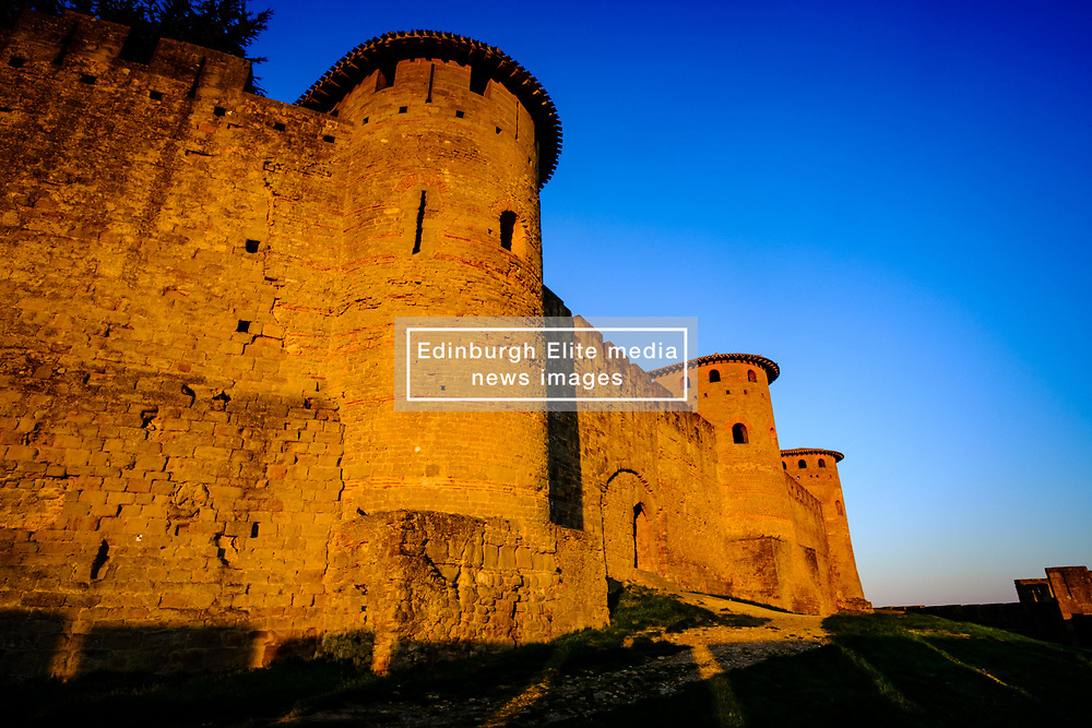 The first rays of dawn sunlight strike the walled Cité de Carcassonne, France - a UNESCO World Heritage Site and France's second most popular tourist attraction.<br /> <br /> (c) Andrew Wilson | Edinburgh Elite media