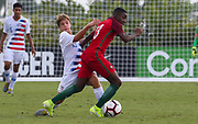 Portugal midfielder Dario Essugo (13) attempts to dribble around Team USA midfielder Pokas Puksas (15) during a CONCACAF boys under-15 championship soccer game, Saturday, August 10, 2019, in Bradenton, Fla. Portugal defeated Team USA 3-0 and advanced to the finals against Slovenia. (Kim Hukari/Image of Sport)