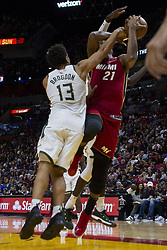 January 14, 2018 - Miami, FL, USA - Miami Heat center Hassan Whiteside (21) is fouled by Milwaukee Bucks Malcolm Brogdon (13) in the second quarter on Sunday, Jan. 14, 2018 at the AmericanAirlines Arena in Miami, Fla. (Credit Image: © Matias J. Ocner/TNS via ZUMA Wire)