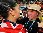 Valerie Adams of New Zealand is congratulated by coach Didier Poppe winning Gold in the Women's Shot Put, and a new Commonwealth Games record. Athletics, Shot Put, Day 6, XIX Commonwealth Games, New Delhi, India. Saturday 9th October 2010. Photo: Simon Watts / photosport.co.nz