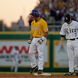05 June 2009:  Sean Ochinko (14) of LSU reacts after hitting a double that knocked in a pair of runs for the Tigers as Brock Holt (7) of Rice looks down following the play during a 12-9 victory by the LSU Tigers over the Rice Owls in game one of the NCAA baseball College World Series, Super Regional played at Alex Box Stadium in Baton Rouge, Louisiana.