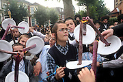 Young Orthodox Jewish boys from the Ashkenazi Nitra sect light torches for the procession of their new Sefer Torah (five books of Moses) before it is paraded to their synagogue from Portland Avenue to Clapton Common.