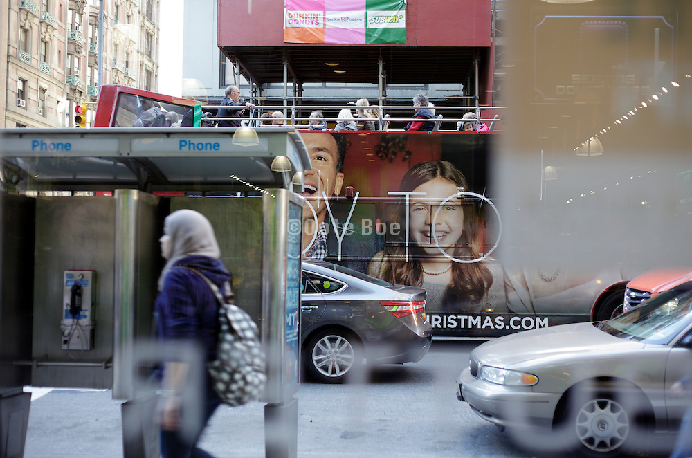 5th avenue New York City street view seen through a window with tourist doubledecker bus