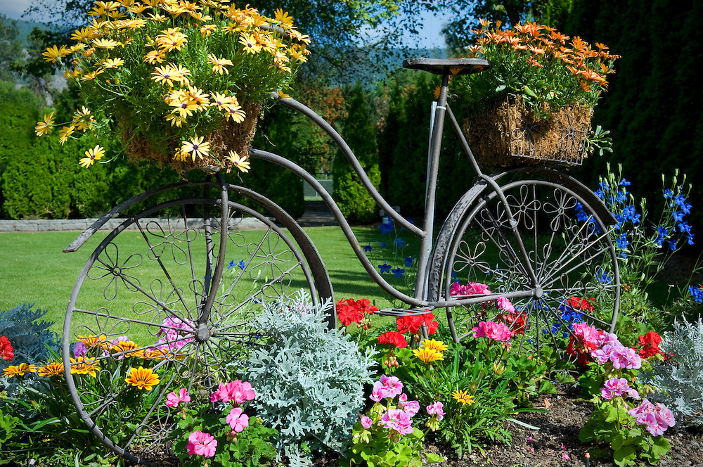 Bicycle sculpture with flower baskets.