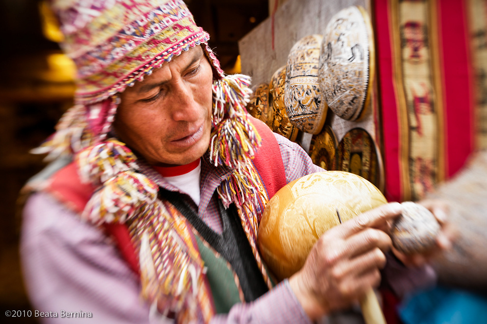 Gourd carver in Chinchero, Peru, explaining Andean cosmology.