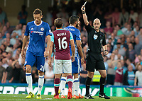 Football - 2016/2017 Premier League - Chelsea V West Ham United. <br /> <br /> Referee Anthony Taylor shows Diego Costa a yellow card for dissent at Stamford Bridge.<br /> <br /> COLORSPORT/DANIEL BEARHAM
