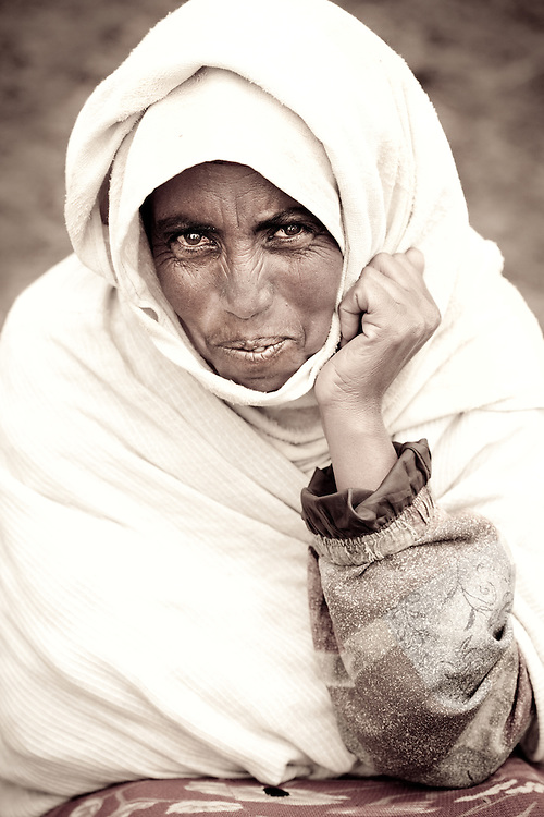 Elderly woman wrapped in a blanket on Market day in Mehal Meda on the Guassa Plateau in the Ethiopian Highlands