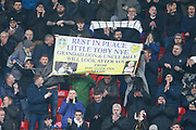 Leeds fans applauding in memory of Leeds fan Toby Nye who died at the age of 6, during the EFL Sky Bet Championship match between Stoke City and Leeds United at the Bet365 Stadium, Stoke-on-Trent, England on 19 January 2019.