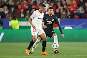 Sevilla forward Luis Muriel (20) battles with Manchester United Defender Chris Smalling during the Champions League match between Sevilla and Manchester United at the Ramon Sanchez Pizjuan Stadium, Seville, Spain on 21 February 2018. Picture by Phil Duncan.