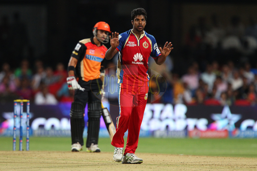 Varun Aaron of the Royal Challengers Bangalore reacts after a delivery during match 24 of the Pepsi Indian Premier League Season 2014 between the Royal Challengers Bangalore and the Sunrisers Hyderabad held at the M. Chinnaswamy Stadium, Bangalore, India on the 4th May  2014<br /> <br /> Photo by Ron Gaunt / IPL / SPORTZPICS<br /> <br /> <br /> <br /> Image use subject to terms and conditions which can be found here:  http://sportzpics.photoshelter.com/gallery/Pepsi-IPL-Image-terms-and-conditions/G00004VW1IVJ.gB0/C0000TScjhBM6ikg