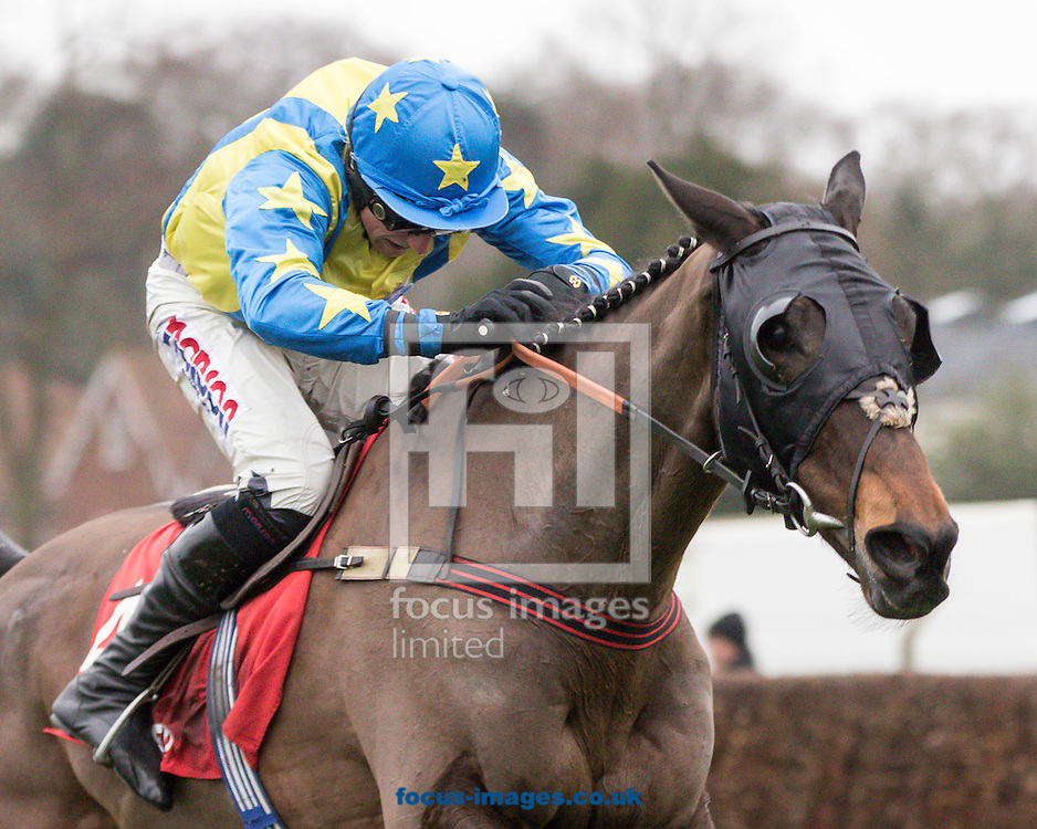 Le Reve ridden by Harry Skelton (Yellow, Royal Blue braces) wins the Betfred Masters Handicap Chase during the Betfred Day at Sandown Park, Esher<br /> Picture by Mark Chappell/Focus Images Ltd +44 77927 63340<br /> 06/02/2016