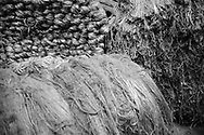 Bales of newly-arrived jute awaiting processing at Tay Spinners mill in Dundee, Scotland. This factory was the last jute spinning mill in Europe when it closed for the final time in 1998. The city of Dundee had been famous throughout history for the three 'Js' - jute, jam and journalism.