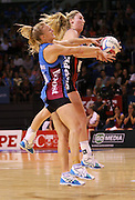 Shannon Francois of the Steel gathers the ball with Zoe Walker of the Tactix in defence during the ANZ Championship Netball game between the Tactix v Steel at Horncastle Arena in Christchurch. 6th April 2015 Photo: Joseph Johnson/www.photosport.co.nz