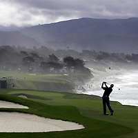 The 9th hole at Pebble Beach provides panoramic views of the Pacific Ocean.