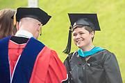 Chloe Musick participates in graduate commencement ceremonies. Photo by Ben Siegel