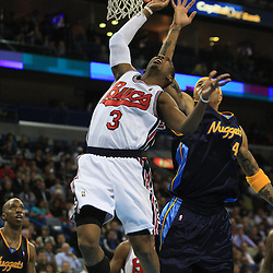 28 January 2009: New Orleans Hornets guard Chris Paul (3) is fouled by Denver Nuggets forward Kenyon Martin (4) during a 94-81 win by the New Orleans Hornets over the Denver Nuggets at the New Orleans Arena in New Orleans, LA. The Hornets wore special throwback uniforms of the former ABA franchise the New Orleans Buccaneers for the game as they honored the Bucs franchise as a part of the NBA's Hardwood Classics series. .