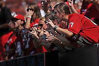 Wolfpack fans cheer as the football team takes the field for warm-ups prior to the game.