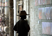 A worker pauses to look at an installation at Gallery 798.
