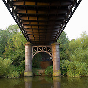 Underside of an old disused railway bridge crossing the River Don, in England