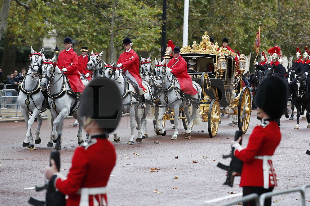 © Licensed to London News Pictures. 14/10/2019. London, UK. Queen Elizabeth II rides the Diamond Jubilee Coach along The Mall to Buckingham  Palace after the State Opening of Parliament. Photo credit: Peter Macdiarmid/LNP