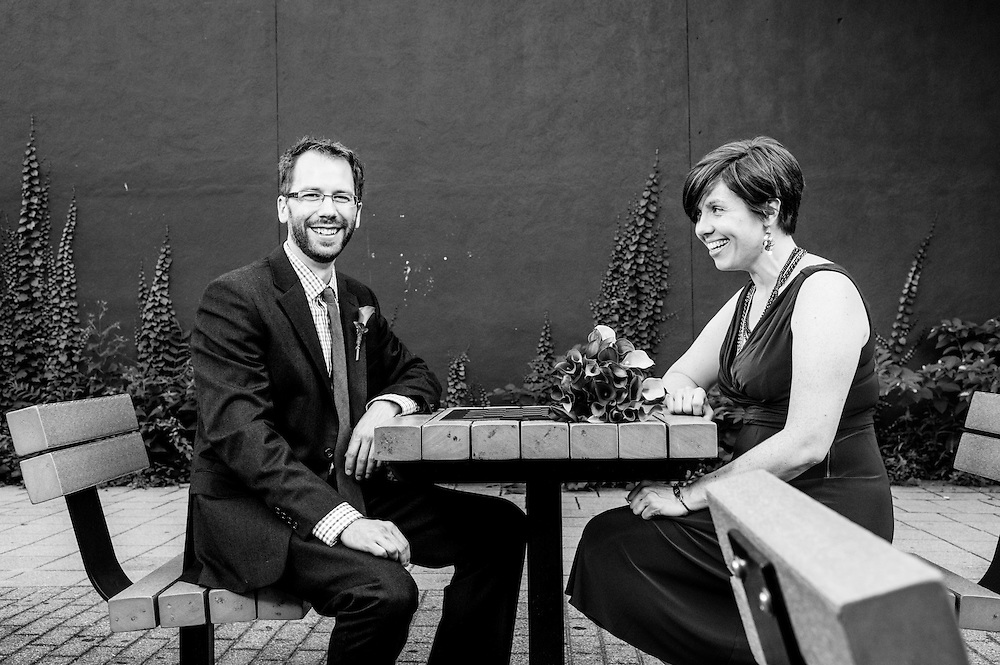 A bride and groom at a checkers table in Waltham, MA.