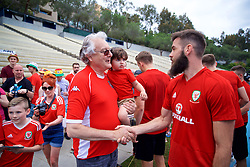LOS ANGELES, USA - Saturday, May 26, 2018: Wales' Joe Ledley meets Mike Young, the creator of cartoon Super Ted, during a training session at the UCLA Drake Track and Field Stadium ahead of the International friendly match against Mexico. (Pic by David Rawcliffe/Propaganda)