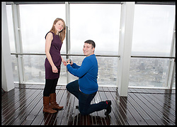 James Episcopate 22 proposes to  Laura Taylor 22 both from Essex, get engaged after being together for 5 years as the  London Mayor Boris Johnson officially opens the Shard building to the General public, central London, Friday February 1, 2013. Photo By Andrew Parsons / i-Images