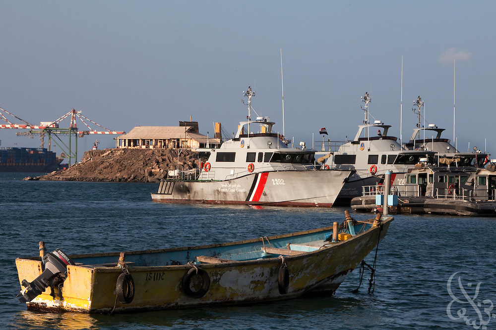 A Yemeni fishing boat sits anchored in shallow water near Yemeni Coast Guard patrol boats April 13, 2010 in the port of Aden, Yemen. A small fishing boat like this one was used in the infamous suicide bombing attack on the United States Navy Destroyer the USS Cole in the port of Aden in 2000.