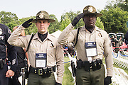 "Ventura County Deputies Steven McKnight and Larry Oriee attend the 34th Annual National Peace Officers Memorial Service to remember their fellow deputy Yehven ""Eugene"" Kostiuchenko at the west lawn of the U.S. Capitol on May 15, 2015. Yehven, a Ukrainian hit by a drunk driver last October who came to the U.S. to investigate a money laundering case and met his future wife. Photo by Kris Connor"