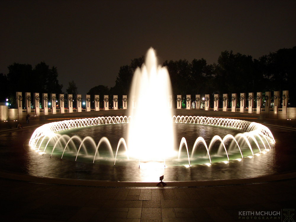 The World War II national monument at night.
